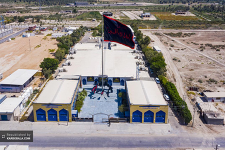 برافراشته شدن پرچم سیاه در نقطه آغازین «طریق الکربلاء» / عکس